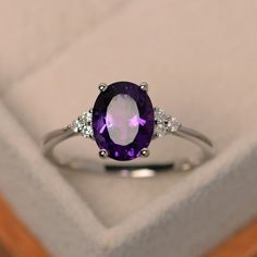 This two tone gold engagement ring is a priceless statement of your love. Handmade in expert detail, this unique moissanite engagement ring is handcrafted with the utmost care and precision. It features a smooth twist band with a diamonds encrusted fl Amethyst Jewelry, Amethyst Gemstone, Purple Amethyst, Opal, Gemstone Rings, Amethyst Rings, Purple Engagement Rings, Diamond Wedding Rings, Ring Engagement