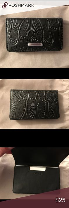 Lodis Denia Mini Card Case Lodis embossed Italian leather case smartly holds all essentials and keeps them secured with a magnetic closure. Holds up to 30 business cards or 12 credit cards Magnetic closure.  Dimensions: 4 x 2.5 x 0.5 Comes with gift pouch and Lodis gift box. Lodis Accessories