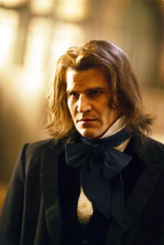 David Boreanaz as Angel/Angelus - vampire villain compelled to be good on the Buffy the Vampire Slayer tv series and spin-off.