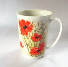 Collectible Fitz Floyd Coffee Mug Neiman Marcus FF Poppy Flowers Floral theme Red / White Holds 8 ounces of beverage Generous unique shaped