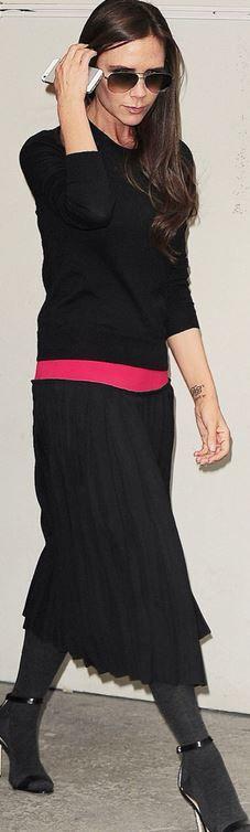 Victoria Beckham: Dress and sunglasses – Victoria Beckham Collection  Shoes – Manolo Blahnik