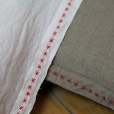 Red star embroidered linen cushions