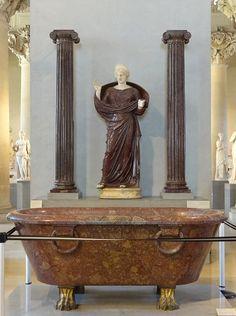 https://flic.kr/p/KPvGXn   Bassin (Rome, 2ème siècle après JC) et femme en prière entre deux colonnes ioniques (Rome, 2ème siècle après JC (?)). Musée du Louvre.