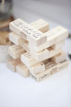 Instead of a guest book, guests signed pieces of a Jenga game for the couple to keep!  Photography by Spring Smith Studios