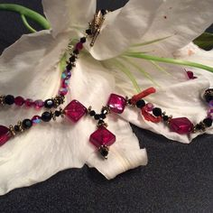 Beaded Necklace Stunning black and red beaded necklace with accenting piece! Perfect for a date night or formal! Has both a magnetic clasp and a pull through clasp! Jewelry Necklaces