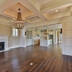 Well detailed living room with coffered ceiling that opens to the kitchen in our #charleston model home in Norton Commons.