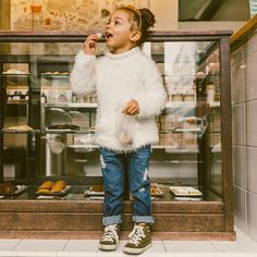 Scouting her favorite cookie shop. (: @drielycarter) distressed denim from @guess Don't forget to stop by the blog today Scoutthecity.com (link in bio)