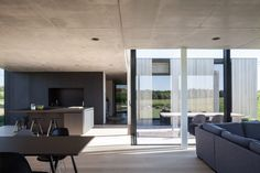 TOOP Architectuur arranges timber and concrete house around a recessed patio