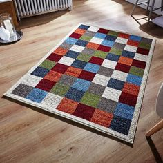 This multicoloured Zante chequered rug is going to uplift your decor in style. It's stain and fade resistant, extremely durable and provide uttermost comfort. #largerugs #durablerugs #polypropylenerugs #multicolouredrugs #chequeredrugs