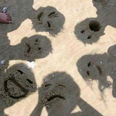 Funny beach sand faces that I am totally doing the next time I am at the beach!