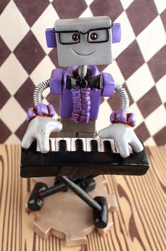 https://flic.kr/p/hjADZQ | Commission: Johnny Diggz Robot Version | Commission. Requested details: based off the Orlando Florida lounge singer, square glasses, ruffle purple shirt and standing with a keyboard. Rustic shabby chic finish.