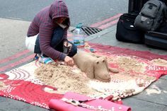 lady creating sand art in London