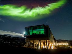 """Located about an hour from Iceland's capital of Reykjavik is the ION Luxury Adventure Hotel, where adventurous travelers embark to experience views of the Northern Lights, go trekking across glaciers, and try fly-fishing in icy rivers. The hotel is located near the """"Golden Circle"""" route and Thingvellir National Park, making it a great starting point for exploring Iceland's landscapes."""