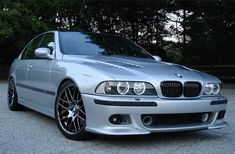 BMW E39 M5 silver with tinted windows, vented hood and sink drain mod
