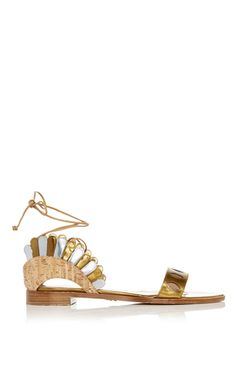 Brazilian verve meets Italian craftsmanship in this street style favorite's colorful, statement making accessories. These **Paula Cademartori** sandals feature a bold scallop design and a cork heel.