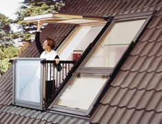 Velux Cabrio Balcony system - you can see one balcony is closed and lays flush to the roof, the other is open - it's soso cute