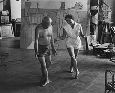 Pablo Picasso and Jacqueline standing in his studio. Picasso is trying to mimic Jacqueline's ballet foot position. Pablo Picasso, Picasso Art, Francoise Gilot, Francisco Goya, Guernica, Lets Dance, Dance Pics, Expo, Brigitte Bardot