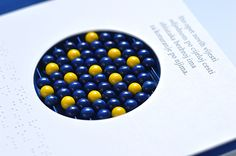 This tactile book has different sounds, as well as textures, along with braille text.