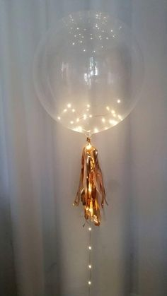 Fairy light clear balloon centrepiece,gorgeous clear balloon with LED fairy lights,balloon tassel,we Balloon Centerpieces Wedding, Balloon Decorations Without Helium, Lighted Centerpieces, Wedding Balloons, Engagement Balloons, Masquerade Centerpieces, Balloon Ideas, Centerpiece Ideas, Clear Balloons