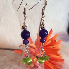 Beaded dangle earrings. Purple and green round beads. Cats eye beads. Silver findings. Unique jewelry.
