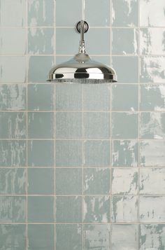 These tiles from The Winchester Tile Company are nice, high gloss and in Cornflower blue. I don't think they are actually glass but they seem it. They sell them at Roma.