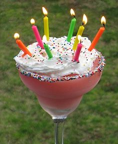 Happy Birthday Colada, made with cake vodka, marshmallow vodka and strawberry rum. Light the candles and sing the song, but blow out the candles before they get to the booze!