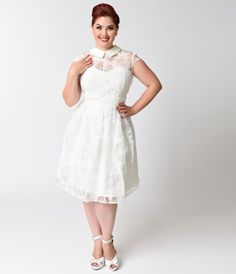Dainty doesn't even begin to describe it, darling. Vera is a plus size vintage infused white dress bursting with feminine class, cast in a playful fit and flare design. A Unique Vintage original, Vera features a notched plain weave contrast collar that re
