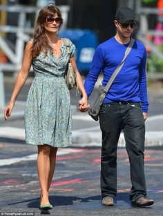 Helena Christensen held hands with her boyfriend Paul Banks while walking through New York City on Saturday, May 31, 2014.