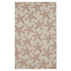 Anchor your living room or define a space in your master suite with this handmade rug, showcasing a starfish motif in antique white.  Product: RugConstruction Material: WoolColor: Antique whiteFeatures:  FlatweaveMade in India Note: Please be aware that actual colors may vary from those shown on your screen. Accent rugs may also not show the entire pattern that the corresponding area rugs have.Cleaning and Care: Professional cleaning recommended