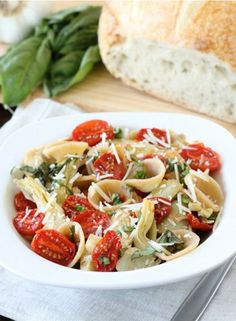 Whole Wheat Orecchiette with Slow Roasted Tomatoes and Artichokes Recipe on twopeasandtheirpod.com Love this simple pasta dish!