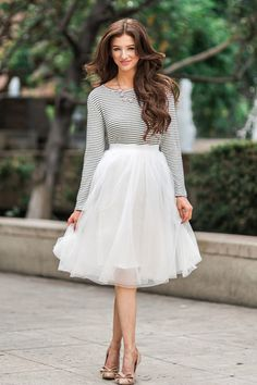 No closet is complete without a white tulle skirt! This pretty midi piece has an elastic waist for a better fit, and layers of soft and delicate tulle! Self: 100% Polyester. Contrast: 100% Polyester.