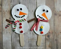 Use white heavy cardstock paper, stick, ribbon, googly eyes and buttons to create a snowman stick puppet.