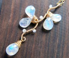 Rainbow Moonstone Necklace, June Birthstone Jewelry, Gold Vine Pendant by Yukojewelry on Etsy https://www.etsy.com/listing/254572582/rainbow-moonstone-necklace-june