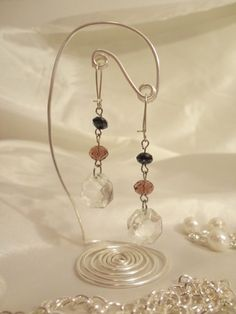 lovely wire display for earrings wonder if Julie could try these