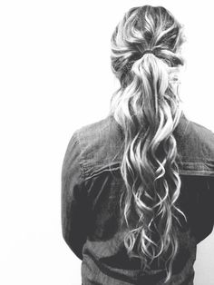 Curly ponytail with some hair down to make the ponytail look longer