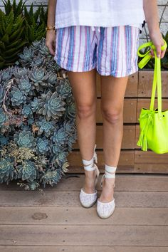 A great neon bucket bag to complete every fun summer look - click to shop it all on The Style Editrix