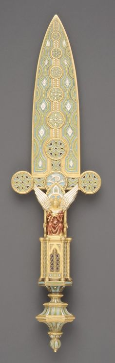 """1863. Italian Paper Knife. Made of Gold with enamel in blue and green in a design of interlaced """"C""""s. Angel in red robes on the hilt by the Firm of Castellani, possibly after a design by Michelangelo Caetani, Duke of Sermoneta (1804–1882)."""