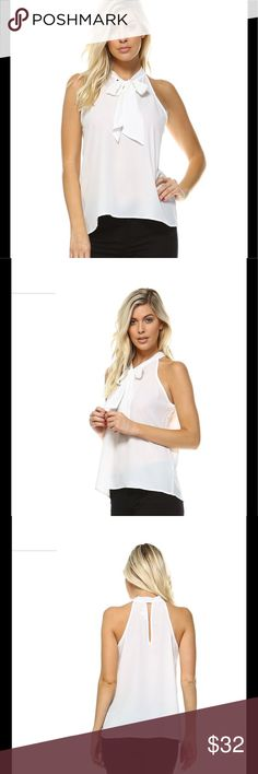 Sleeveless Dobby Top Sleeveless Self Tie Dobby Top. 100% polyester. Model is wearing a size small. Tops Blouses