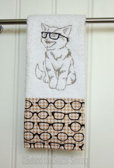 A cat with glasses embroidered on a towel? What could be better? Behind the Seams Sewing