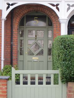 I love a matching front door and gate: try Farrow and Ball Card Room Green from How To Choose The Perfect Front Door Colour For Red Brick Houses on Modern Country Style Green Front Doors, Modern Front Door, House Front Door, Painted Front Doors, Front Door Colors, House Entrance, Farrow And Ball Front Door Colours, Exterior Shutter Colors, Exterior Front Doors