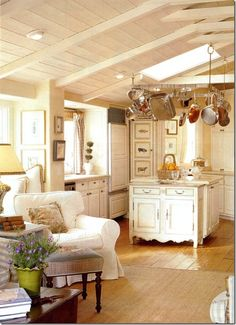 The small but very pretty kitchen lives large with the family of five. Soft white paint covers the rustic vaulted ceilings and keeps the area light.