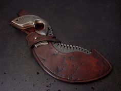 Custom fixed blade knife with etched stainless steel blade and sheath.