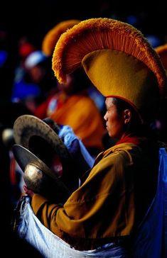 Monk playing cymbals at Mani Rimdu festival