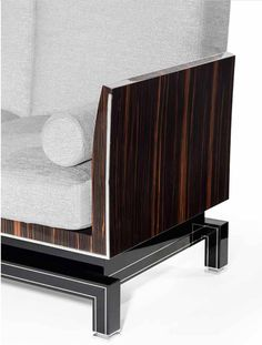 Armchair covered in fabric. Structure in shiny varnished ebony wood and black lacquered wood with inserts in shiny stainless steel.  Design Giovanni Luca Ferreri #gianlucaferreri