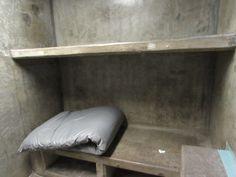 Bunk of an empty segregation cell at California State Prison-Sacramento.