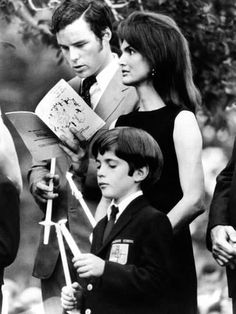 Photo: Jacqueline Kennedy Onassis and Son John Kennedy Jr Attend Memorial Mass : 24x18in