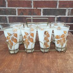 Mid-century 8 piece Glassware with Brass Carrier *Free Shipping * by BrocanteTreasuresTX on Etsy https://www.etsy.com/listing/289234843/mid-century-8-piece-glassware-with-brass