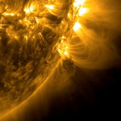 Monday, Jan. 6, 2014: A dark clump of plasma rose above the sun, then twisted and spun before breaking away and dissipating on Dec. 16-17, 2013. (The clump appears in the center of the image below the bright loops.) This image comes from a 12-hour video clip which showed magnetic forces pulling the clump in different directions before a coronal mass ejection thrust it into space. The large loops emerging from the sun north of the small mass trace magnetic field lines above several active…