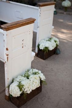outdoor ceremony w/ vintage pews and window box floral decor