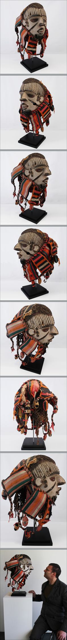 Helmet mask, Igbo, Nigeria. Very colorful helmet mask of a male from the Igbo people of Nigera. It's powerful in form and whitened with a t...